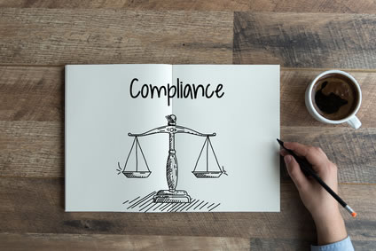 Compliance text above scales of justice illustration
